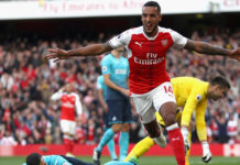 Arsenal hang on to beat Swansea