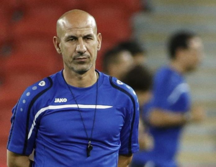 Iraq's head coach Shenaishil