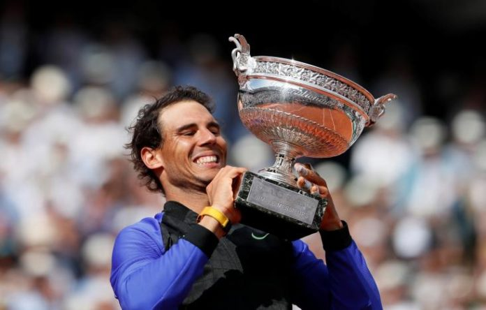 Rafael Nadal celebrates with the trophy after winning the final against Switzerland's Stan Wawrinka